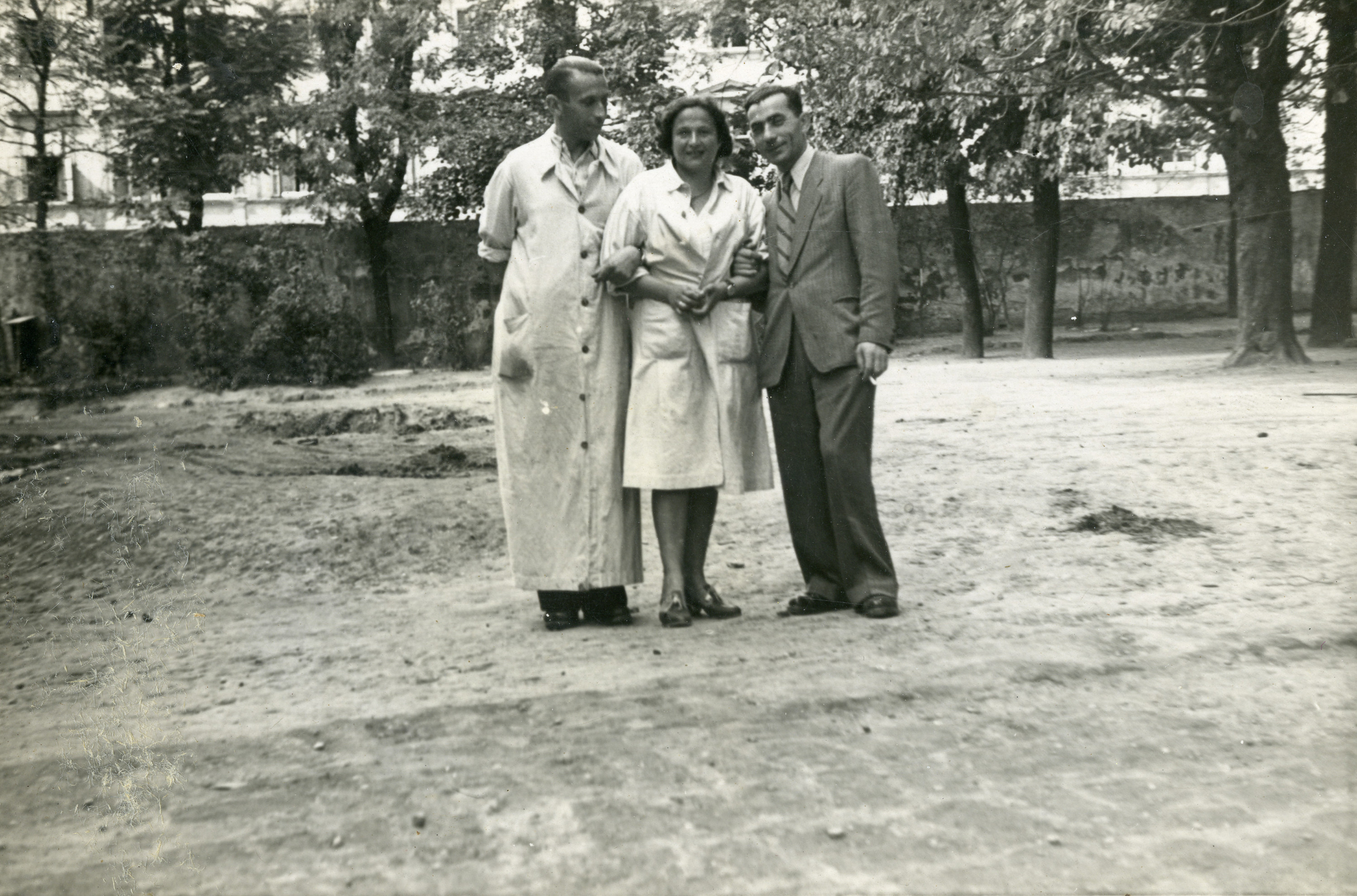 Dr. Georg Kollman (left) stands with a nurse and an UNRAA staff member, probably on the Rothschild hospital grounds.