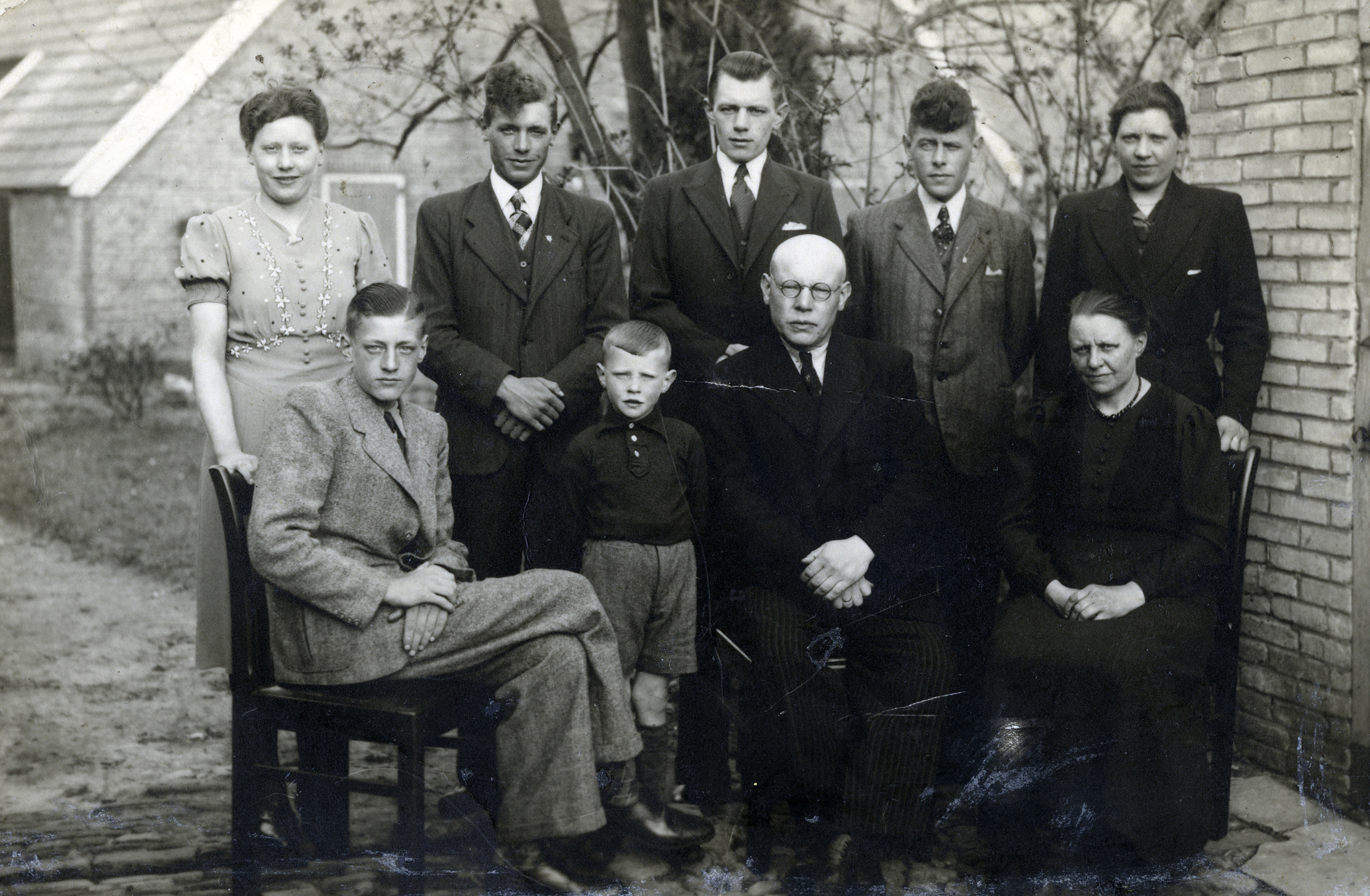 Postwar portrait of a Dutch rescuer family.  Among those pictured are parents Tai and Aaltjie Katerberg (seated, right) and their daughters Tina (standing, far left) and Jante (standing, far right).