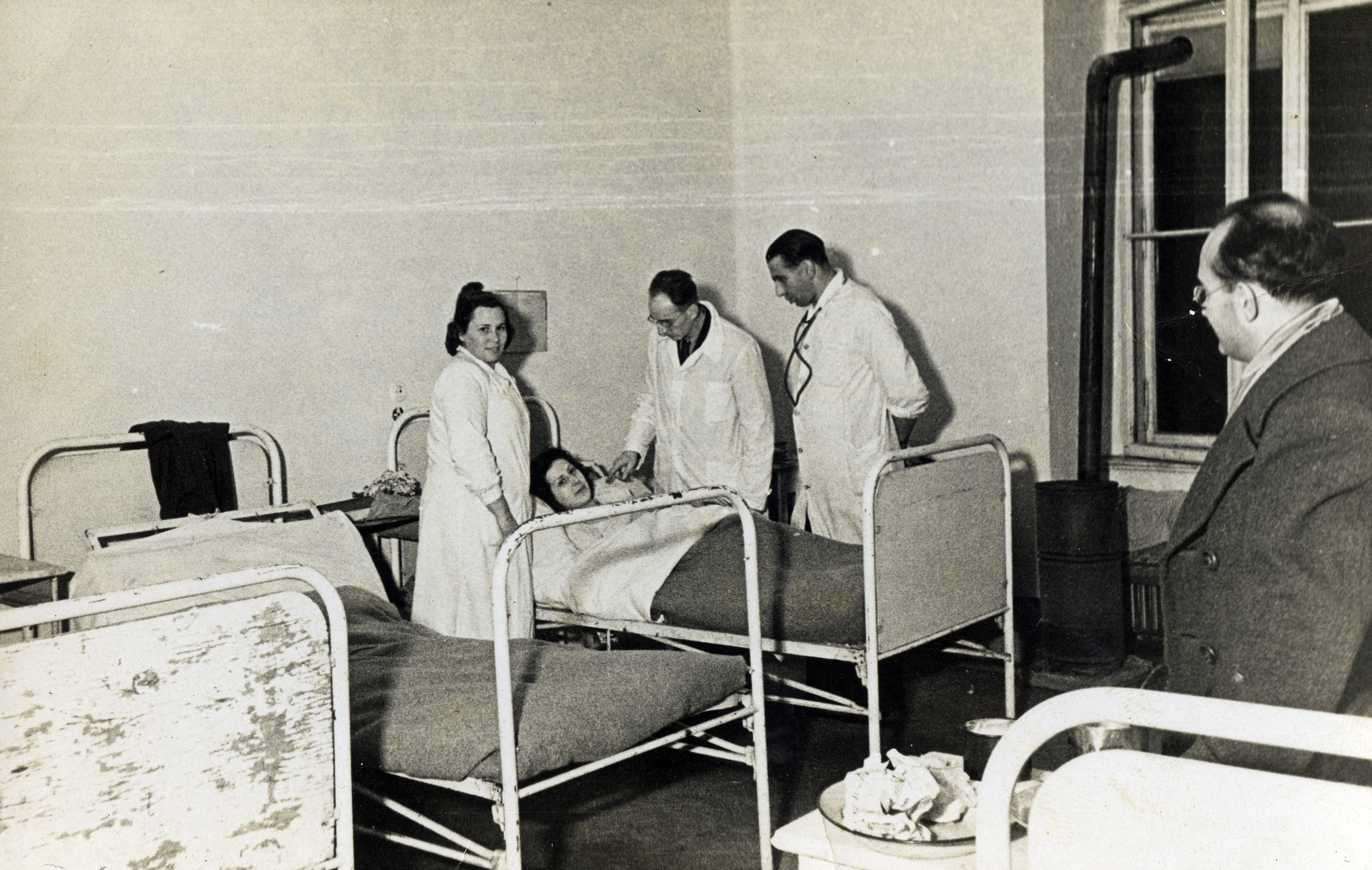 Medical personnel tend to a patient  at the Rothschild Hospital in Vienna.    Among those pictured is Dr. Georg Kollman (standing by the bed, on the right).