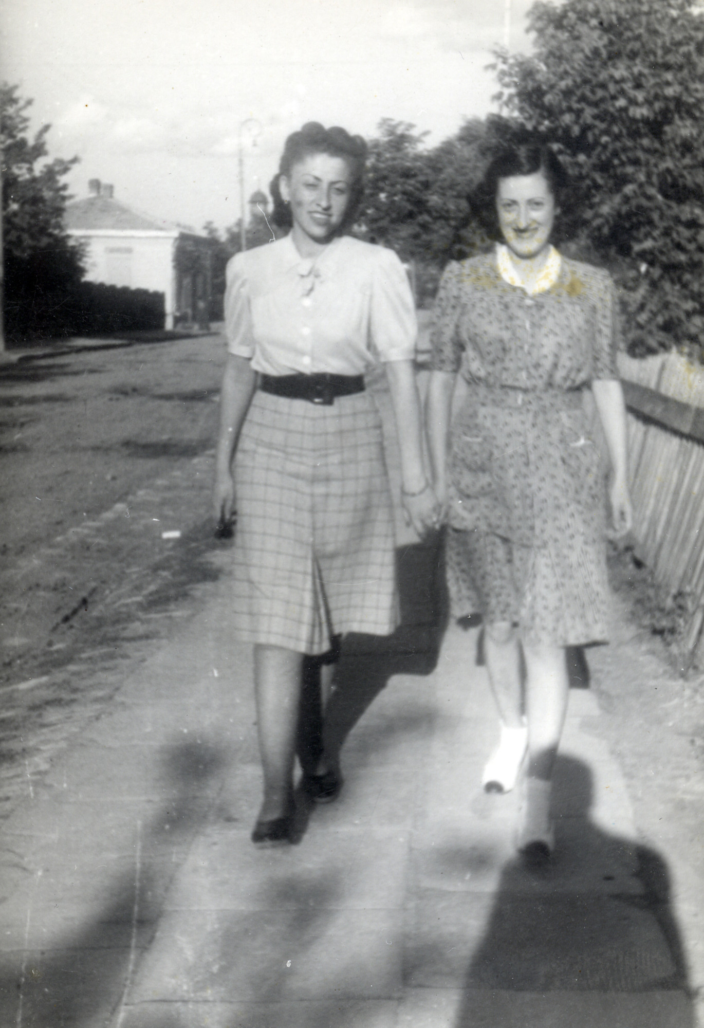 Rivka Kreisel walks down the street with her cousin Genny in their hometown of Dorohoi, Romania.