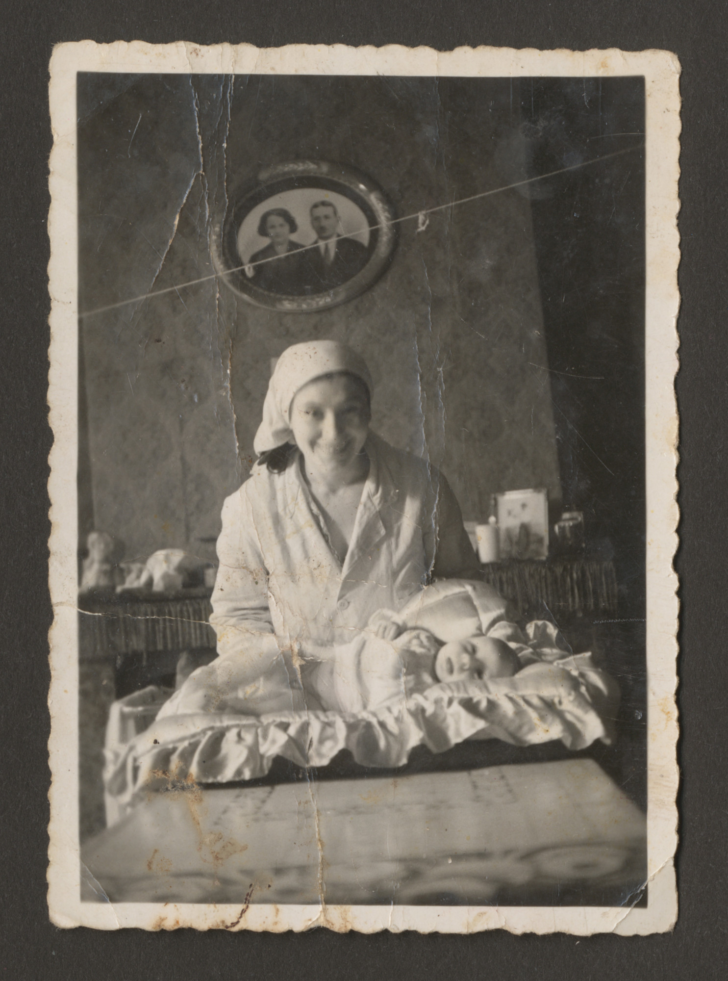 A Belgian Jewish mother and her baby son at his bris.  Pictured are Maria and Charles Srebnik.
