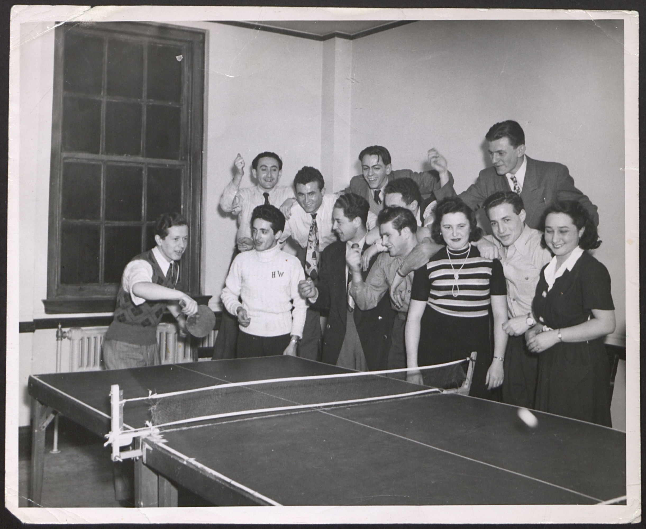 DP youth play ping pong at the Kloster Indersdorf DP children's center.
