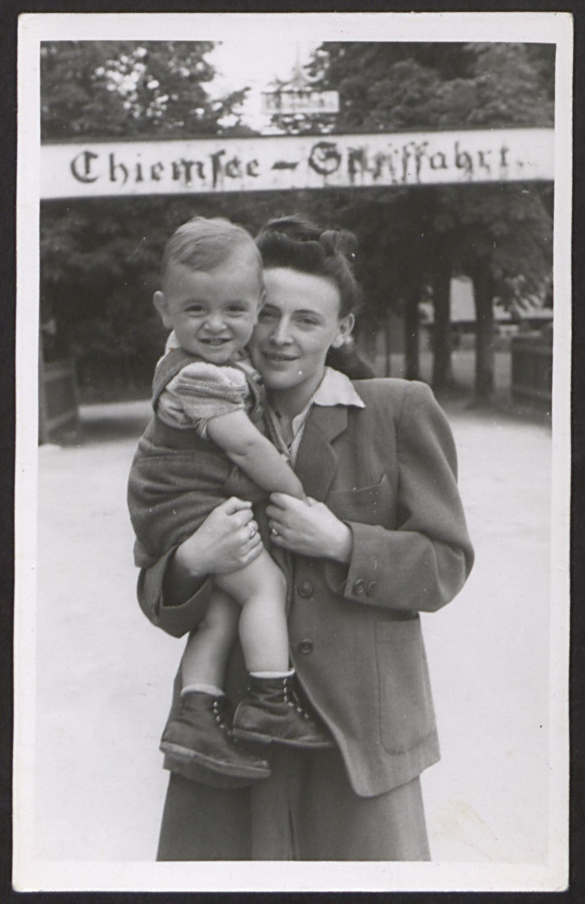 An UNRRA relief worker poses holding her son at the International Children's Center at Prien am Chiemsee.  Pictured is Judith Gruber holding her son, Jack.  Judith and her husband  Samuel Gruber were in charge of the Children's Center in Prien.