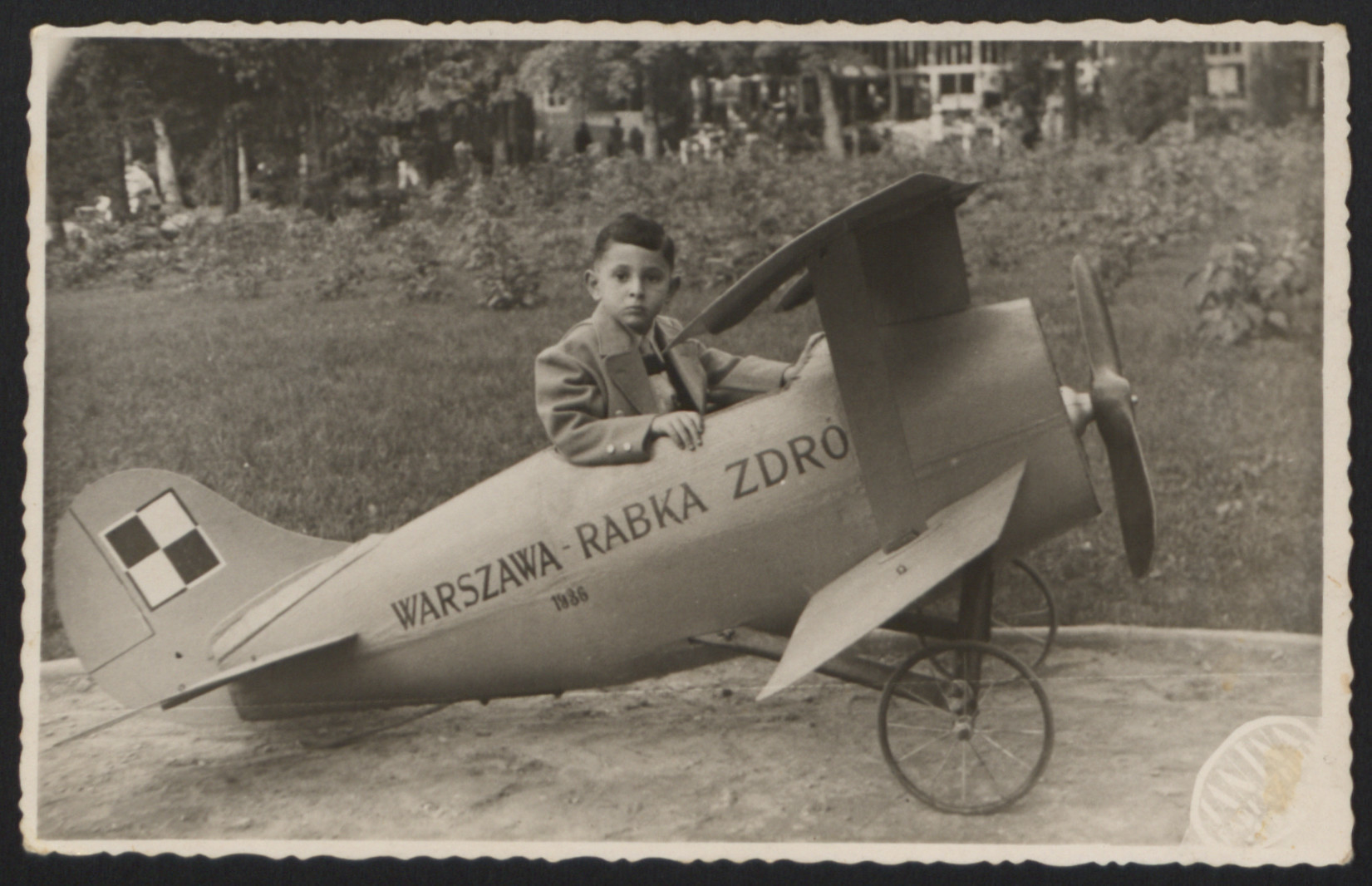 Dawid Tennenbaum poses in a toy airplane while on vacation with his parents.