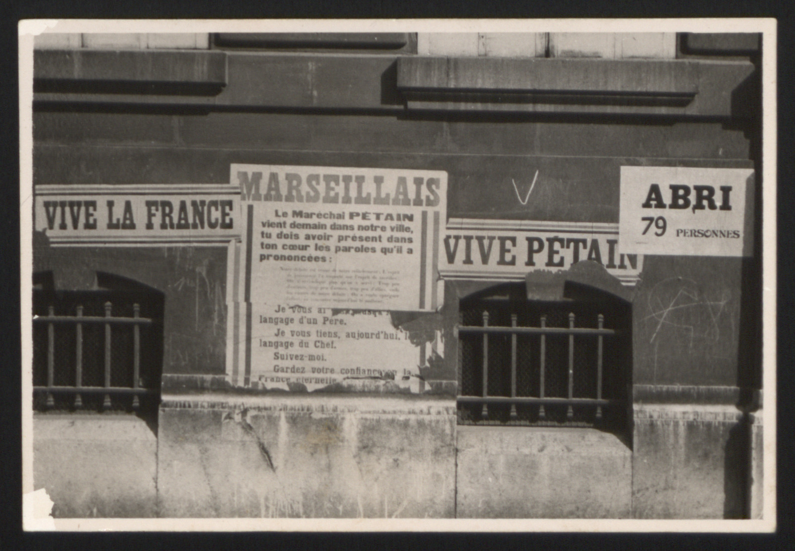 An array of posters announcing the arrival of Marshall Petain to Marseilles.