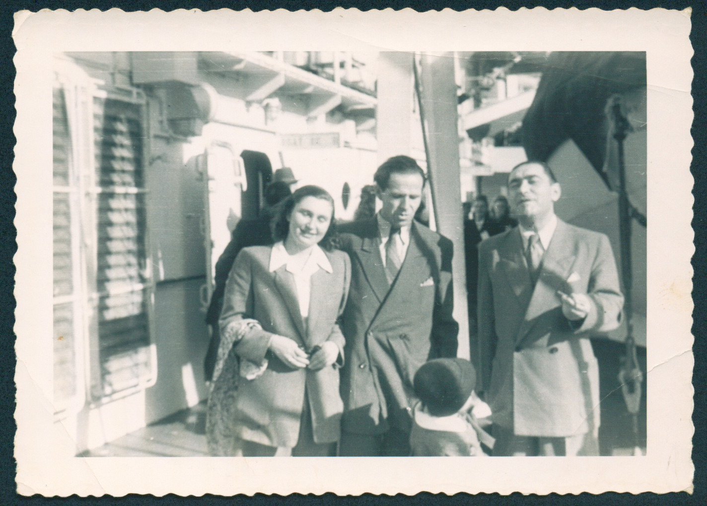 Ada and Rafael Abrahamer pose with a friend on the deck of the General Black.