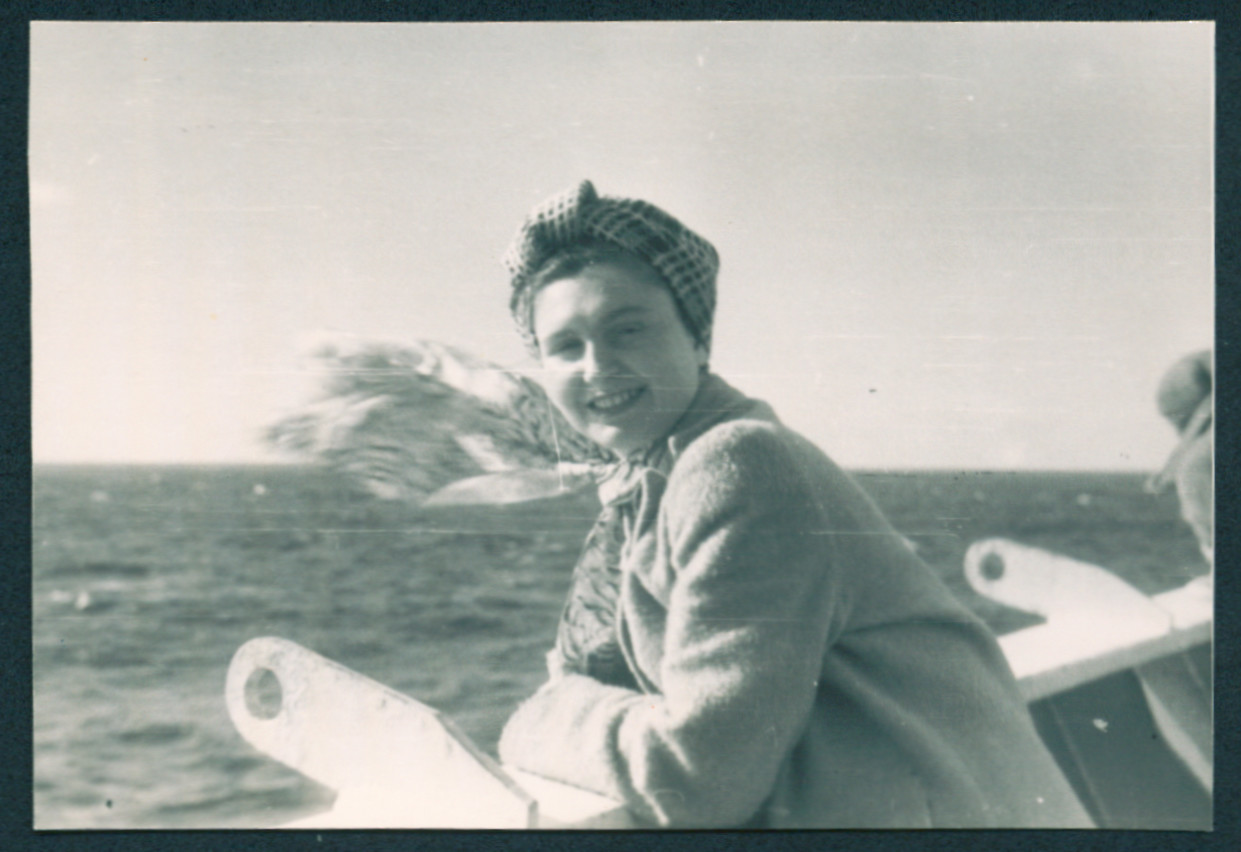 Ada Abrahamer leans over the deck of the General Black while en route to the United States.
