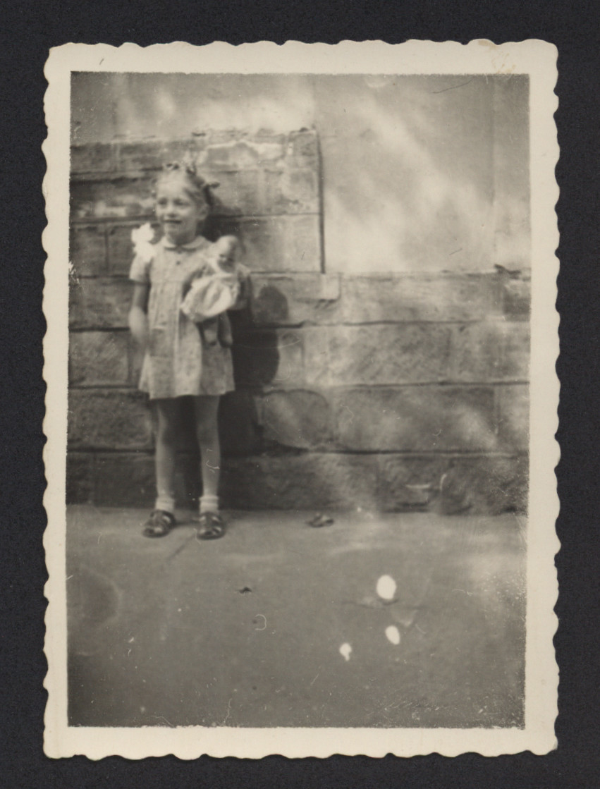 Renee Lyszka holds her doll either while in hiding or immediately afterwards.