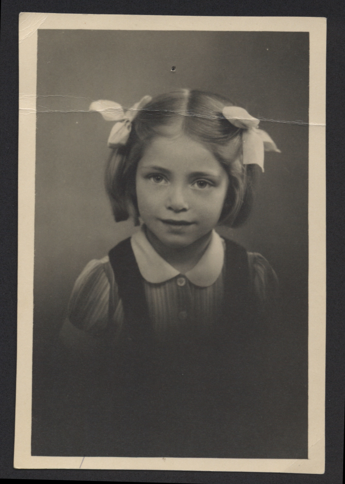 Studio portrait of five-year-old Renee Lyszka taken shortly after the end of the war.