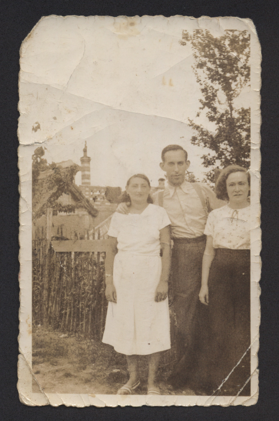 Three members of the Cwajgenbaum stand outside in prewar Poland.  Pictured are Gittle Cwajgenbaum with her daughter Sara and an unknown man.