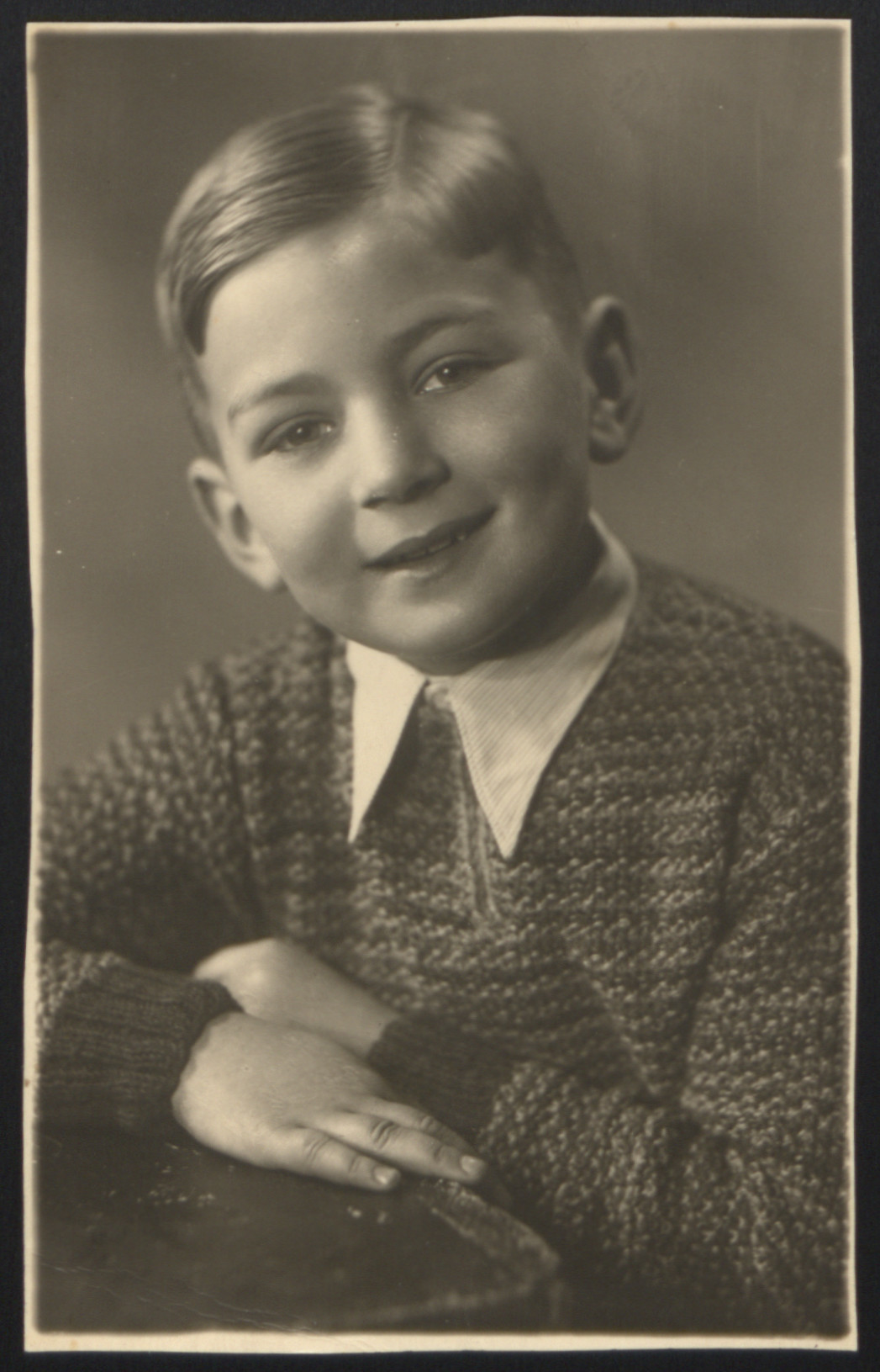 Portrait of eight-year-old Roman Haar while living in hiding in Rzeszow, Poland.