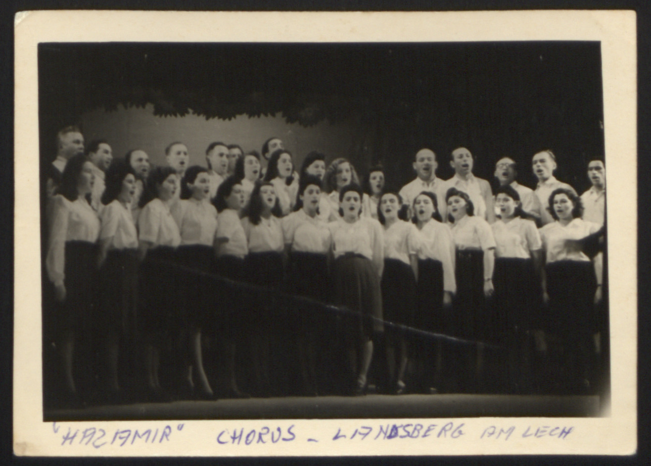 Group portrait of members of the Hazamir Chorale in the Landsberg displaced persons camp.  Among those pictured is Nechama Santocki (second from the left).