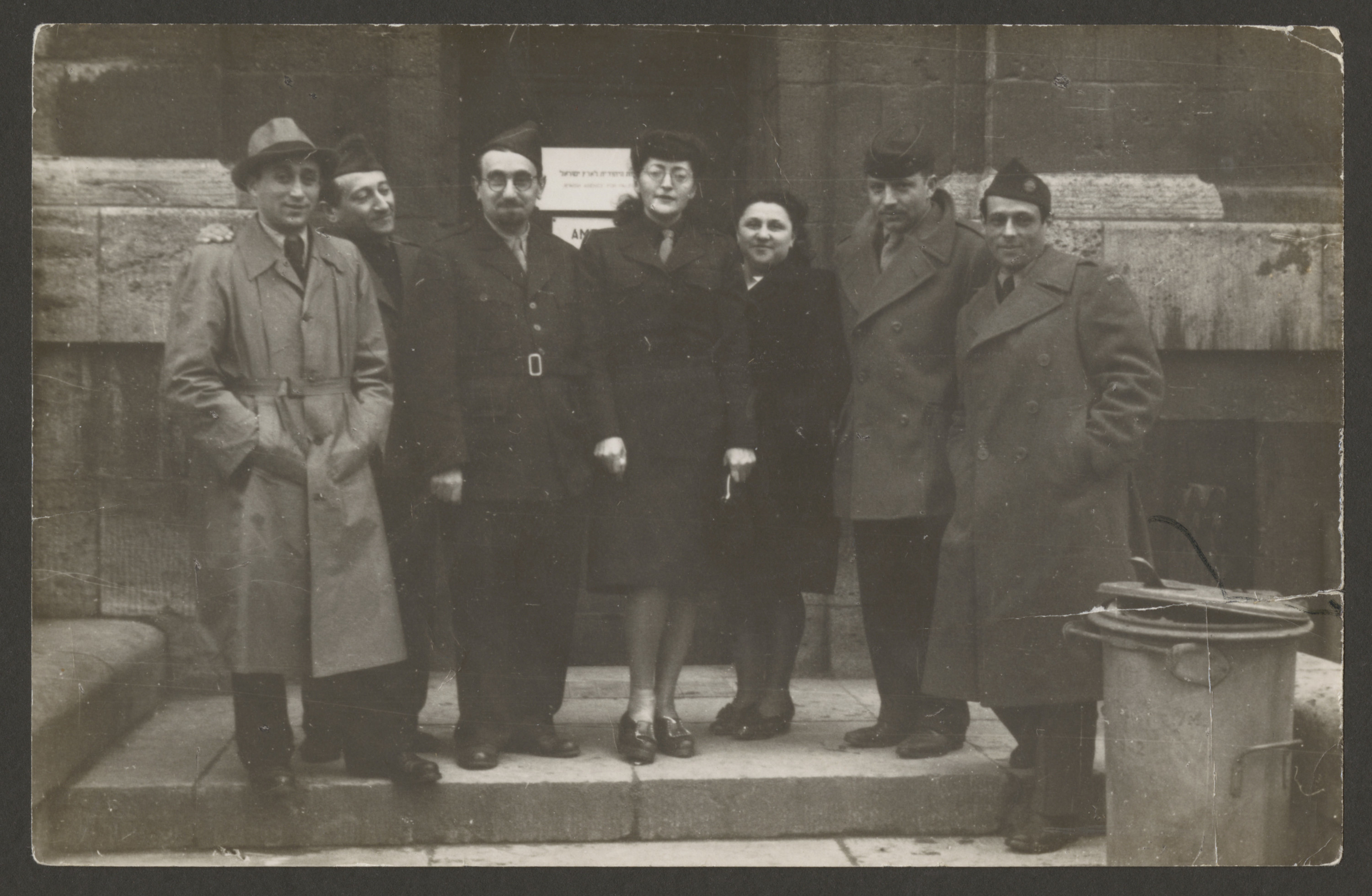 The staff of the Vaad Hatzala office in Frankfurt stands outside its office.  Among those pictured are Rabbi Aviezer Burstin (third from left.) and Ann Goldman (center).