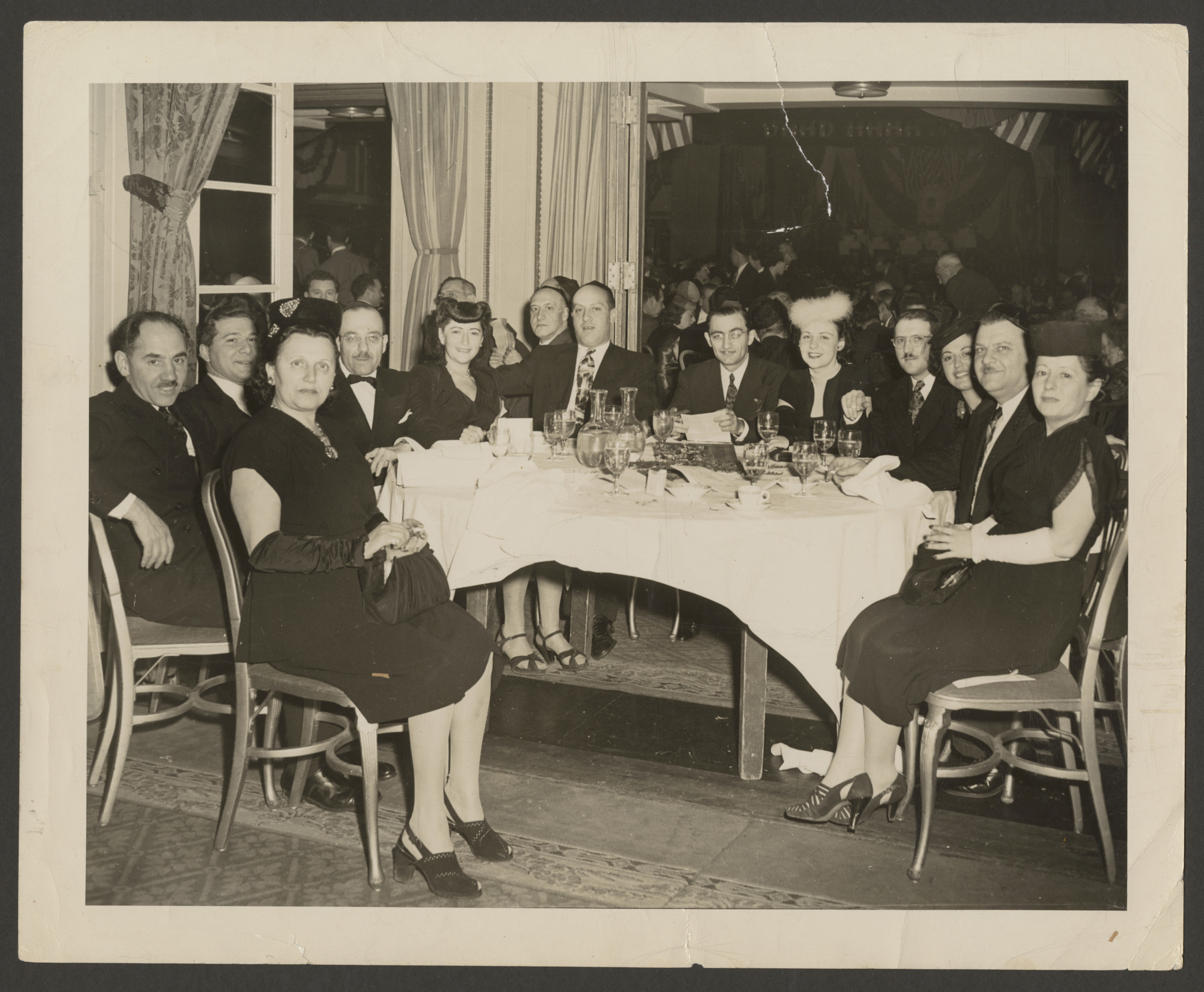 Vaad Hatzala dinner at the Hotel Astor honoring Sec. of the Treasury Henry Morenthau.  Ann Goldman is seated fifth from left.