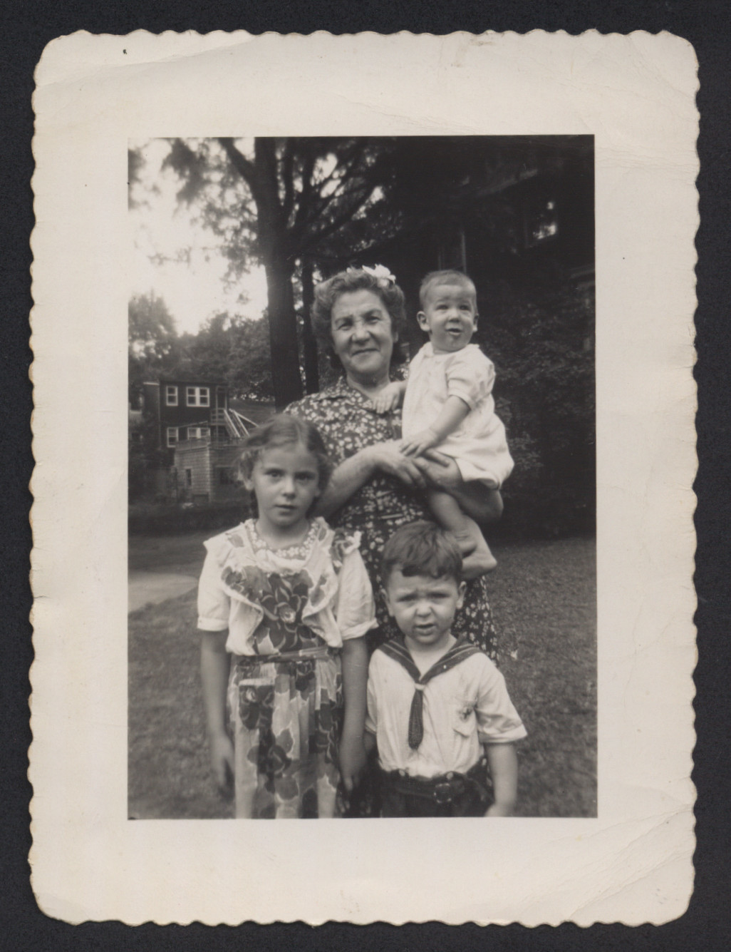 Prewar mother and three grandchildren standing outside.    Pictured are probably Zelda Gulst and three children of one of Joseph's siblings.