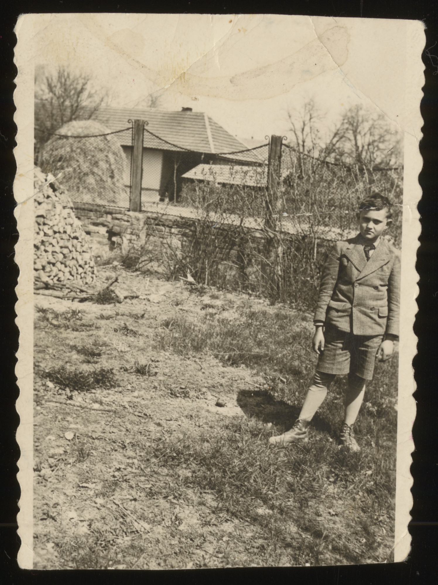 Gabriel Groszman poses in the yard adjacent to a home.