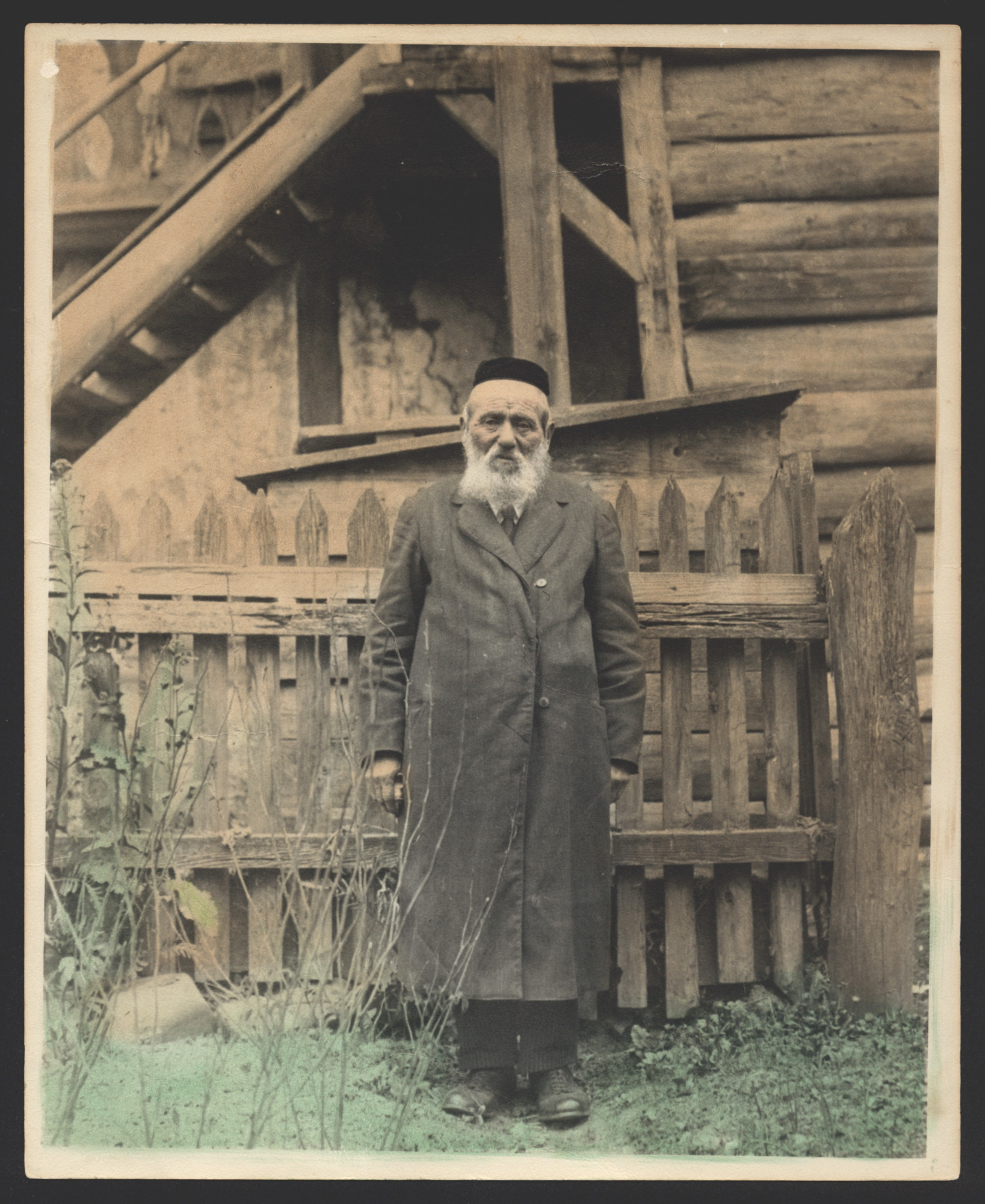 Portrait of Hersh Heller, maternal grandfather of Erwin Tepper, in front of a home.