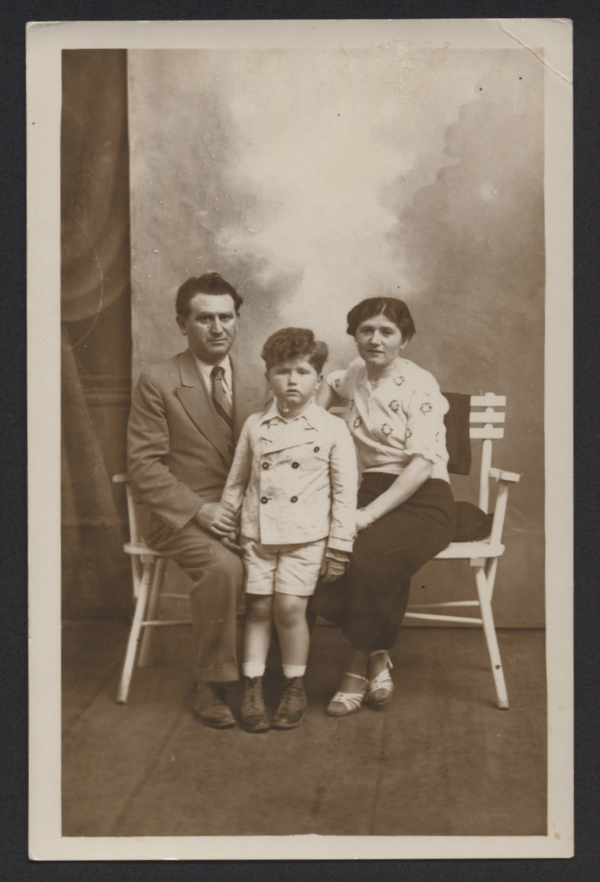 Studio portrait of Erwin Tepper and his parents, Juda and Schifra Tepper.