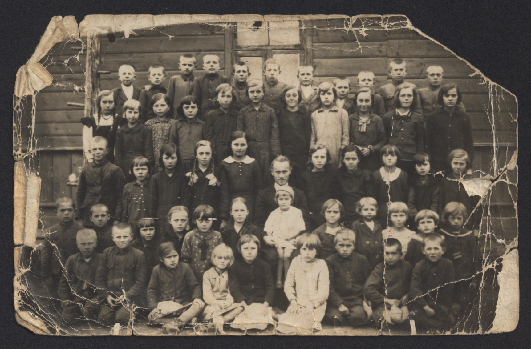 Group portrait of school children in Sawin, Poland.  Malka Rajzl Zytnik is pictured fourth from left in second row from the top.