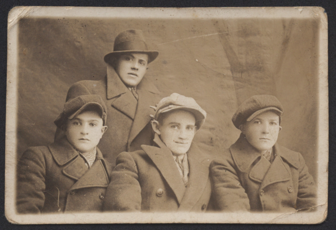 Group portrait of four Jewish youth in prewar Sawin.
