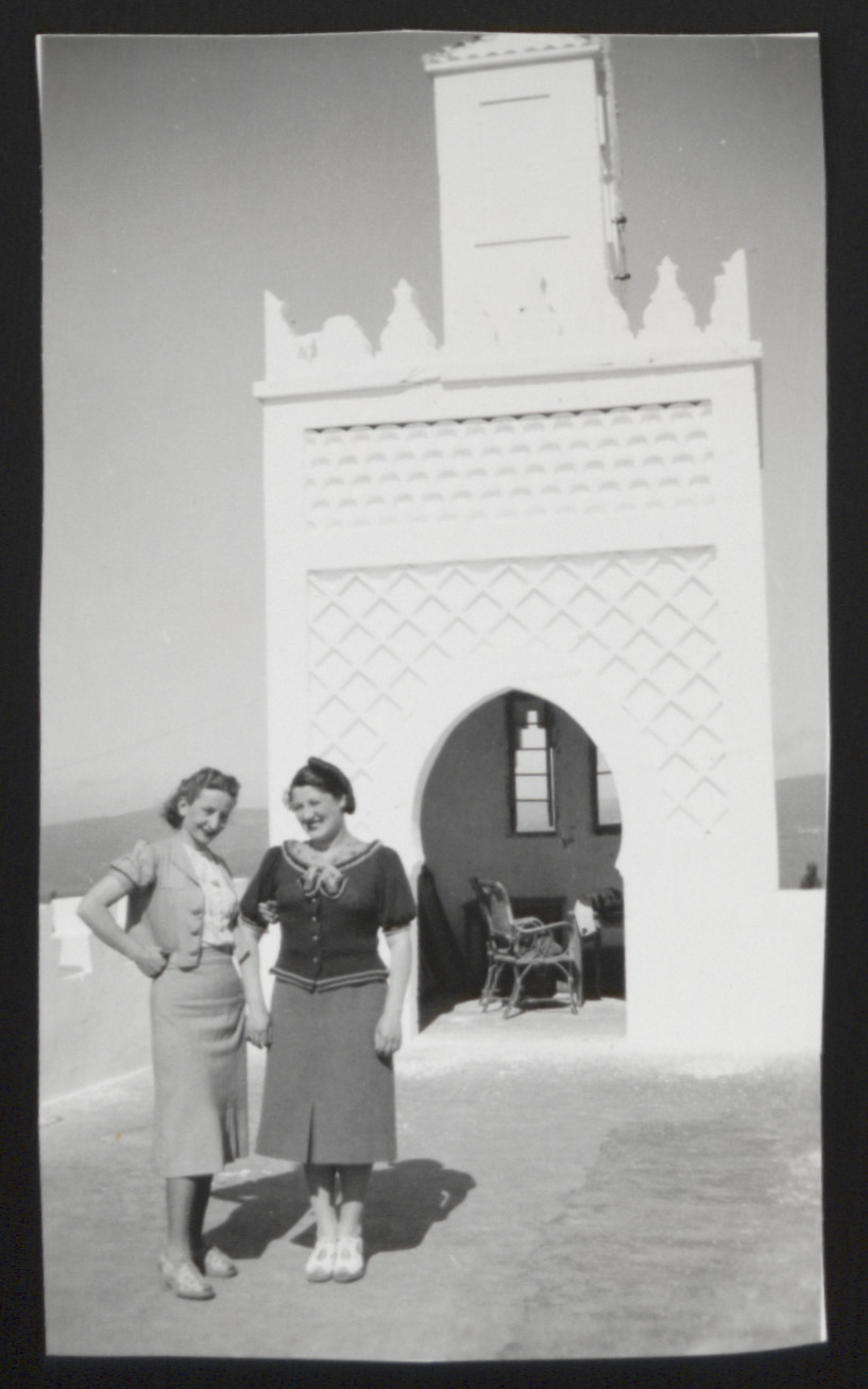 Lilly Roth and a friend pose outside an ornate arch in Tangier.