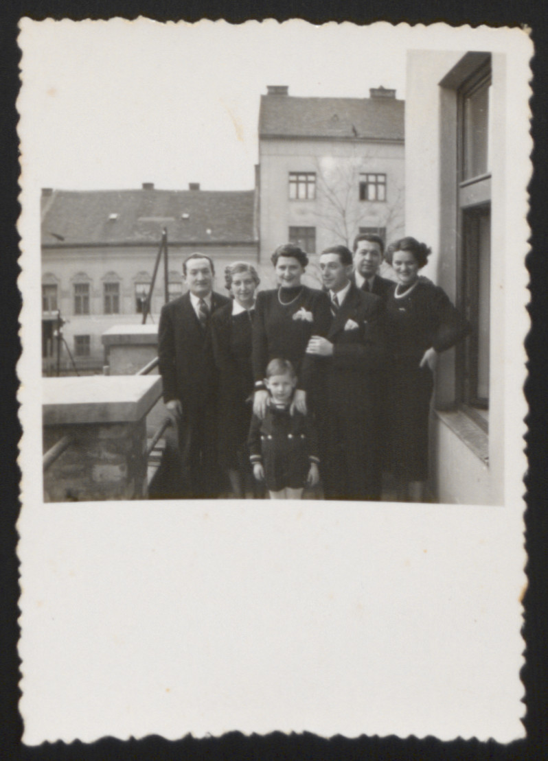 The extended Vandor-Merei (Merey) family poses outside its home in Budapest.  Pictured from left to right are: Andor Vandor, Ibolya Vandor, Luba Merei, Dr. Ladislav Merei, Ernest Merei (Merey). Ernestine (Ily) Merei (Merey).  The boy in the front is Peter Vandor.