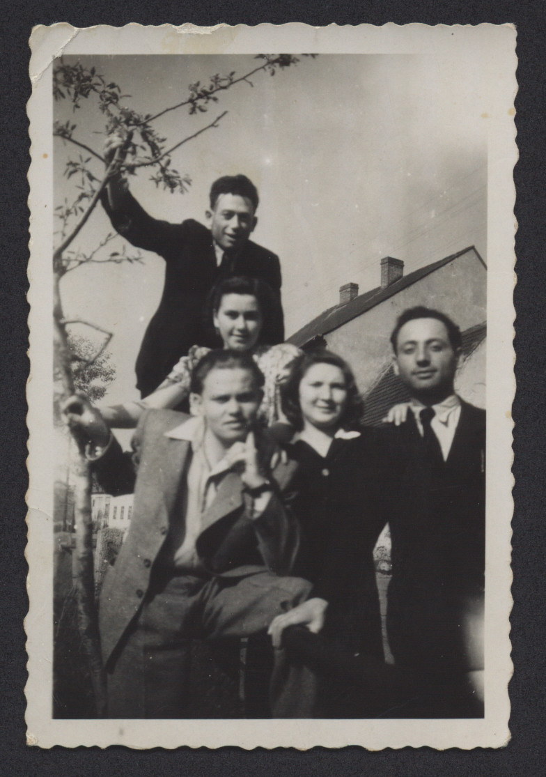 Portrait of five young people in the Deggendorf displaced persons camp.  Lenke Gruenberg is pictured in the bottom, center.