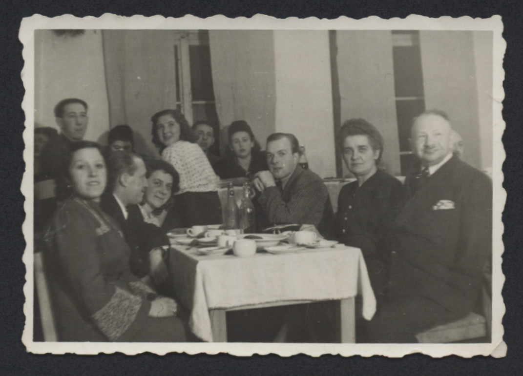 Jewish DPs gather in the Deggendorf dining room.  Pictured in the rear center in the white shirt is Lenke Gruenberg.