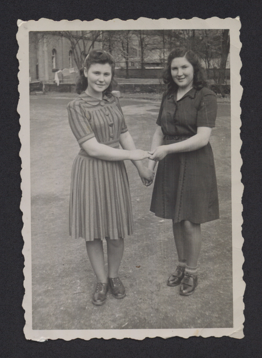Close up portrait of Lenka Gruenberg (left) and her friend Maya Batarin in the Deggendorf displaced persons camp.