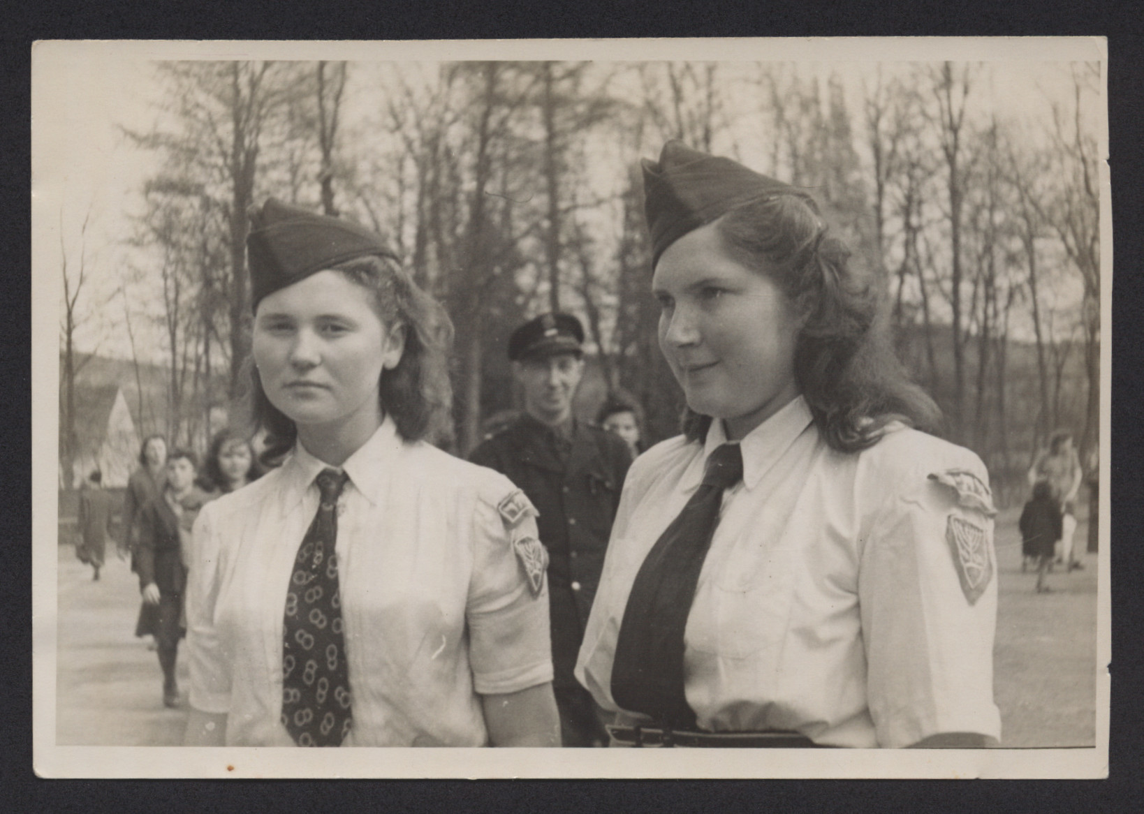 Close-up portrait of Lenka Gruenberg (right) and Maya Batarin wearing their Betar uniforms.
