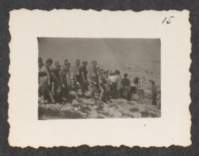Jewish refugees from the shipwrecked Pentcho line up to receive  their ration of provisions, on the island of Kamilonissi.