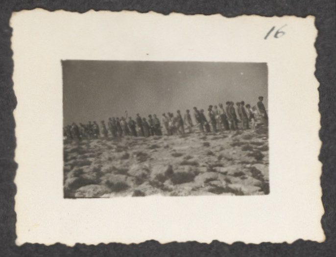 Jewish refugees from the shipwrecked Pentcho line up to receive  their ration of provisions [probably] on the island of Kamilonissi.