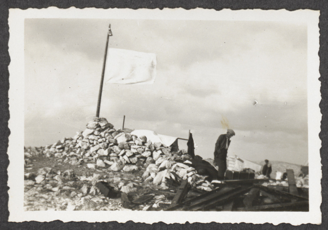 A white flag is raised on the island of Kamilonissi at the location of the shipwrecked Pentcho, in a attempt to attract assistance.