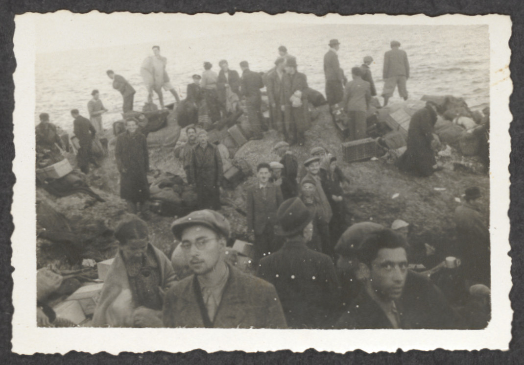 Jewish refugees from the shipwrecked Pentcho stand amid their luggage, on the island of Kamilonissi.