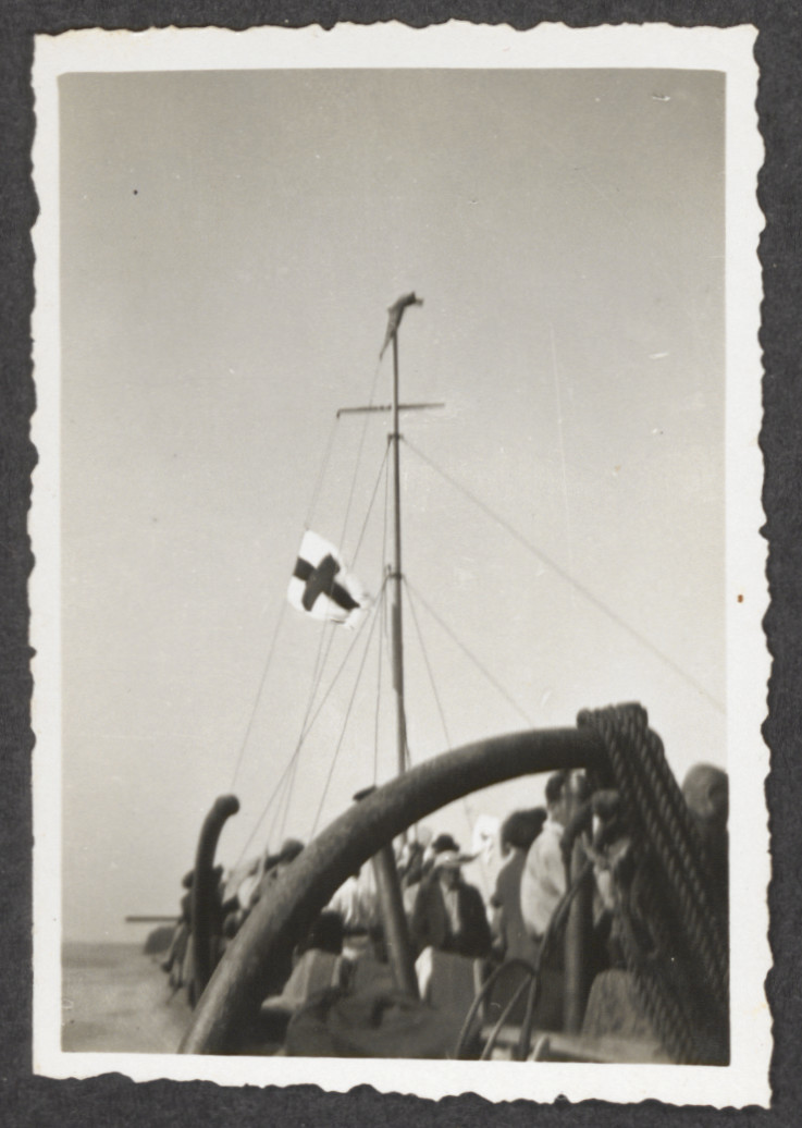 Passengers raise a white flag with Red Cross above the Pentcho after its shipwreck.