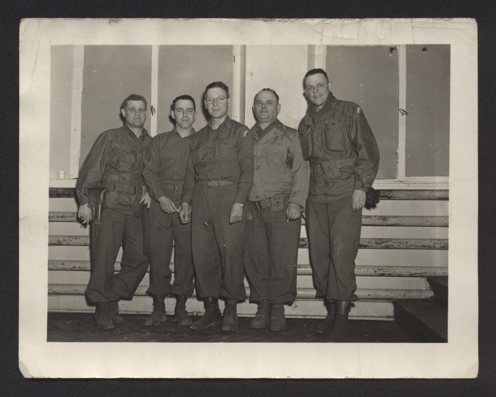 Group portrait of American GIs from the 42nd Rainbow Division.  Rabbi Major Eli Bohnen is in the center.