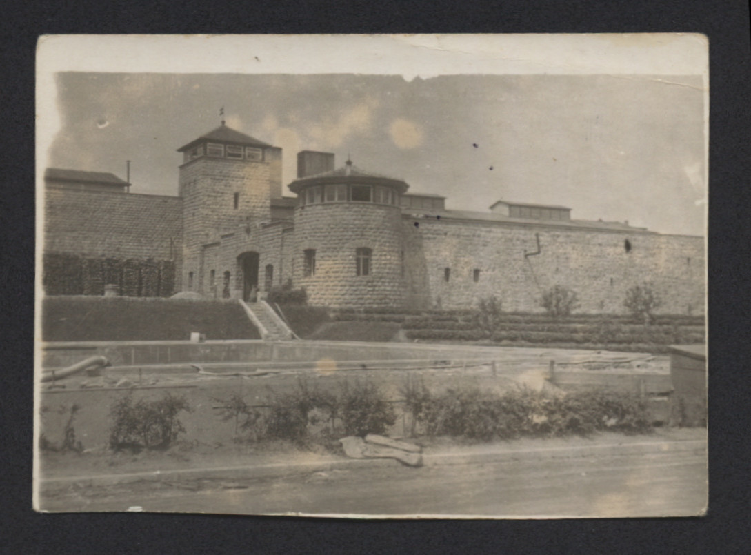 """View of the exterior of Mauthausen concentration camp.  The handwritten inscription on the back of the photograph reads, """"Mauthausen prison camp."""""""