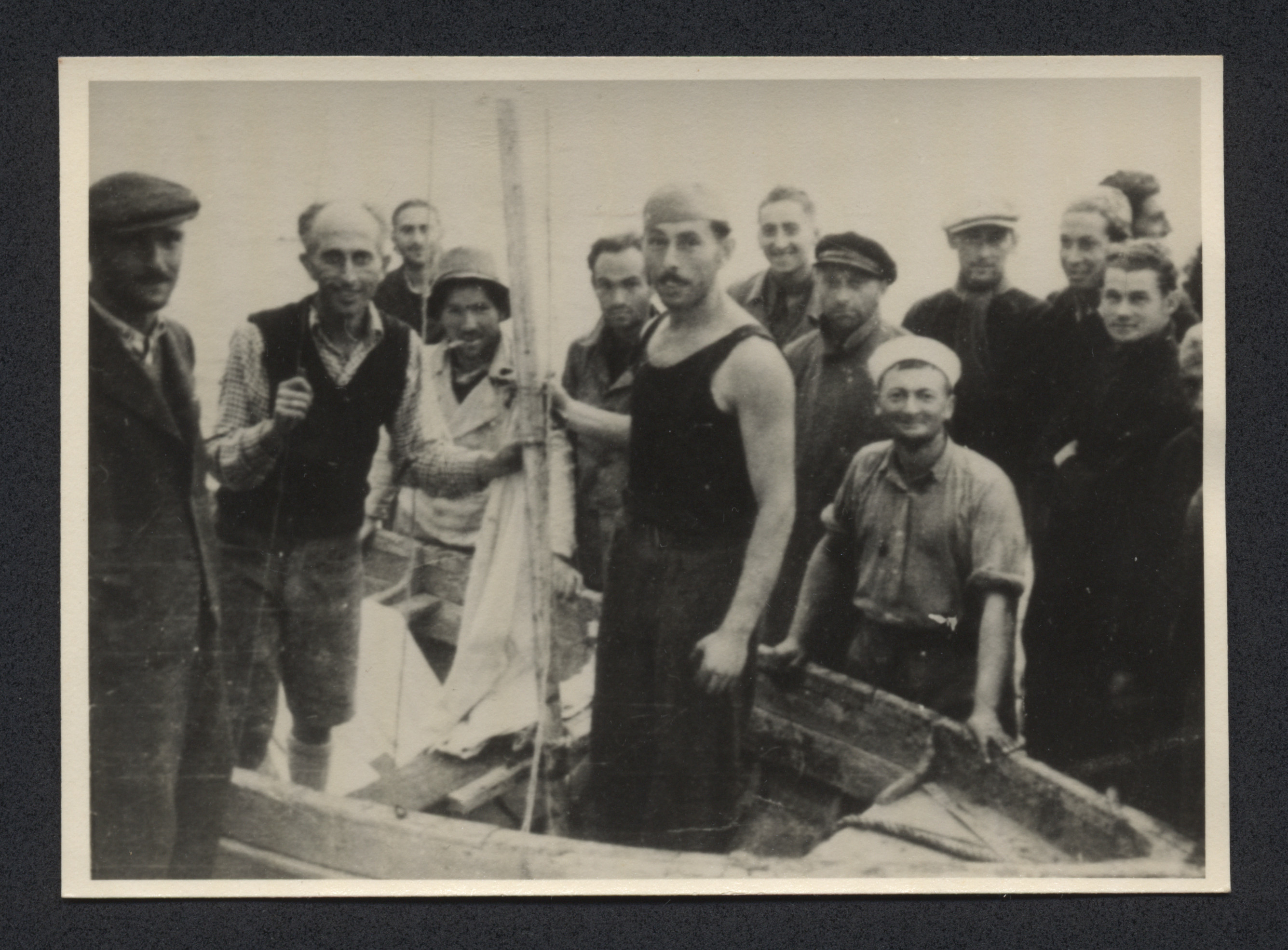 Survivors of the shipwrecked Pentcho refugee ship prepare a rescue boat to look for help.