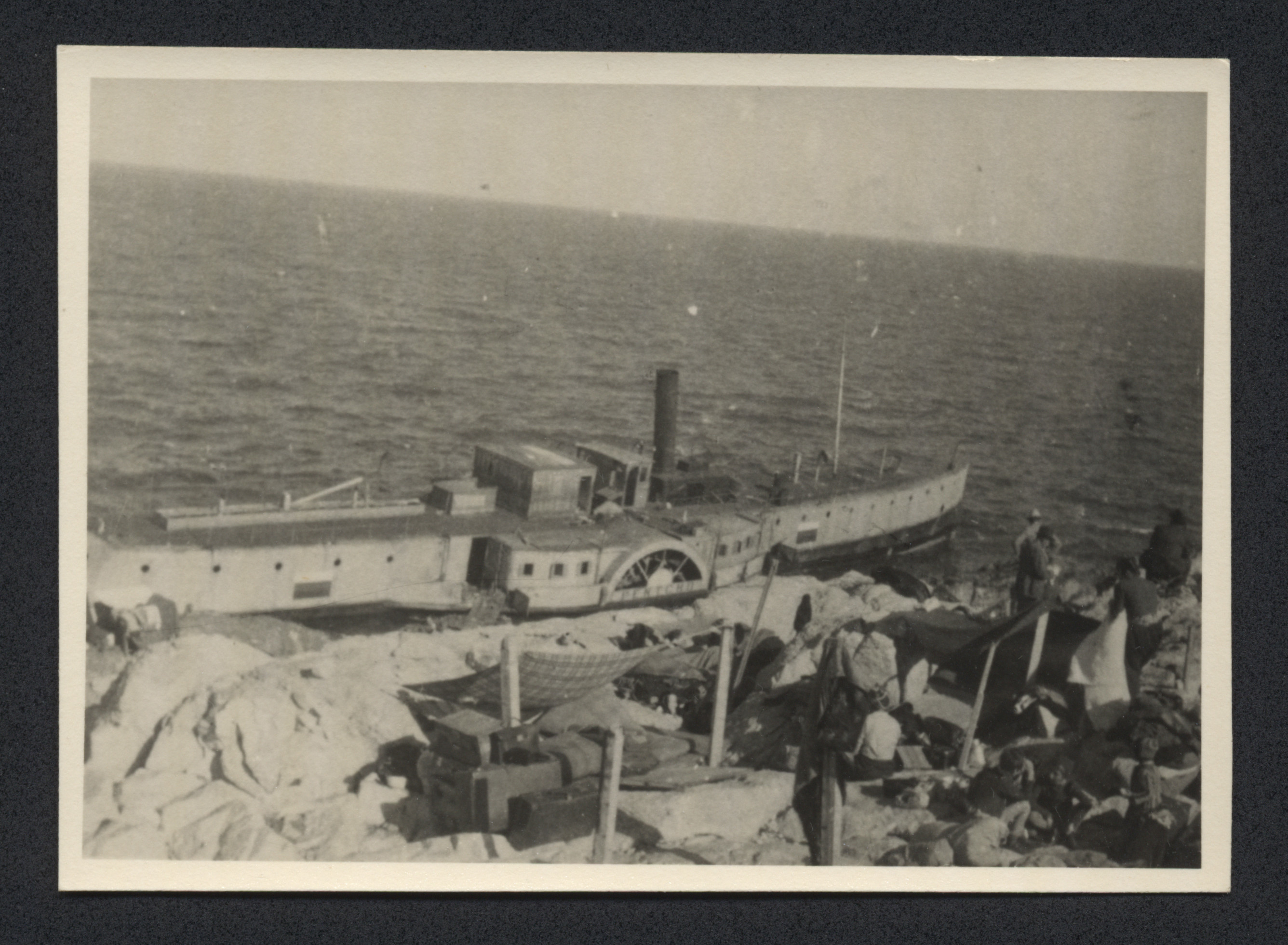 View of the shipwrecked Pentcho and the crude shelters built by the refugees on the island of Kamilonissi in the Aegean Sea.