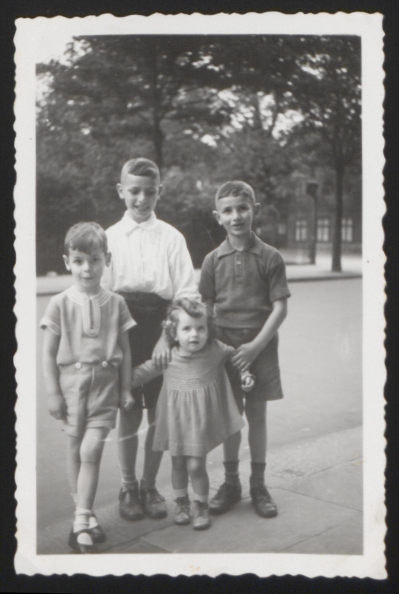 Photograph of siblings Elliot, Karl Heinz, and Wolgang Rosner (L-R) with cousin Betty Klarberg.   The photograph was taken prior to Betty's immigration to the United States.