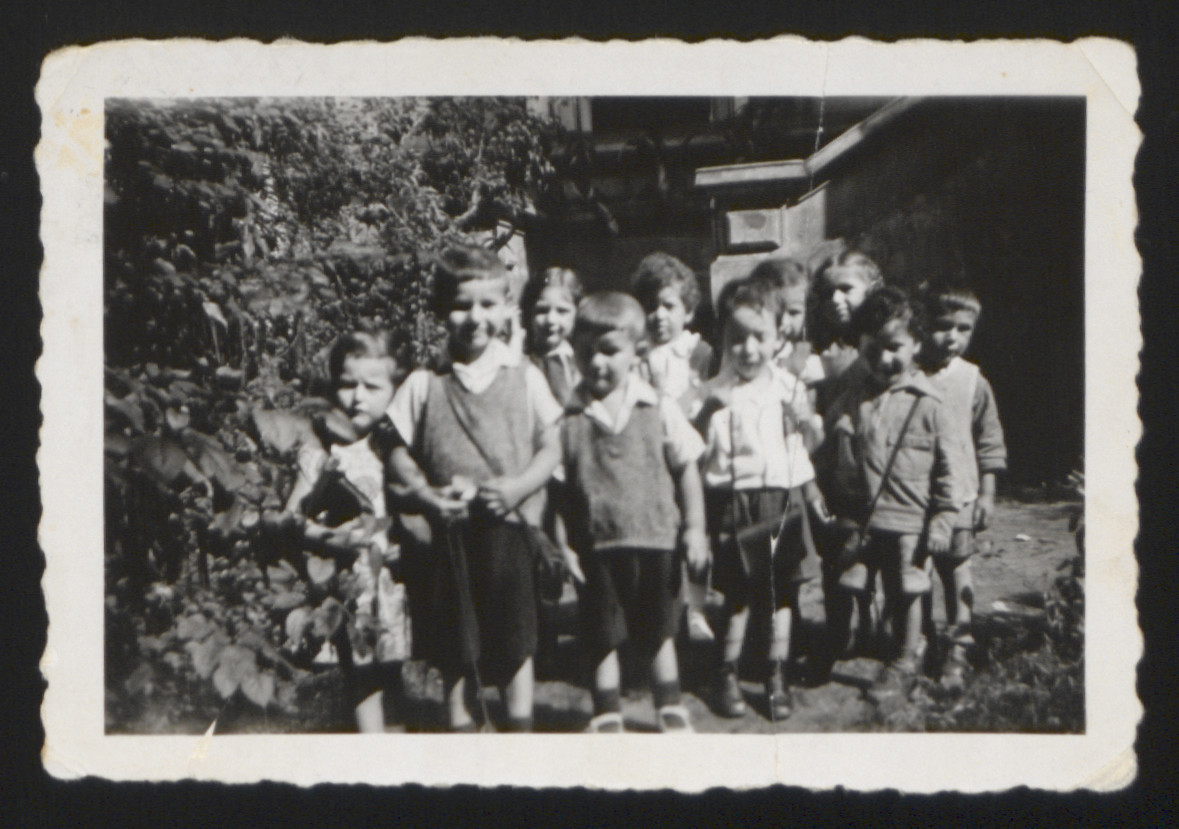 Portrait of a kindergarten class in Paris, France.  Among those pictured are Karl Heinz Rosner and his brother Wolfi (now Joseph) (standing front row, second and fourth from the left).