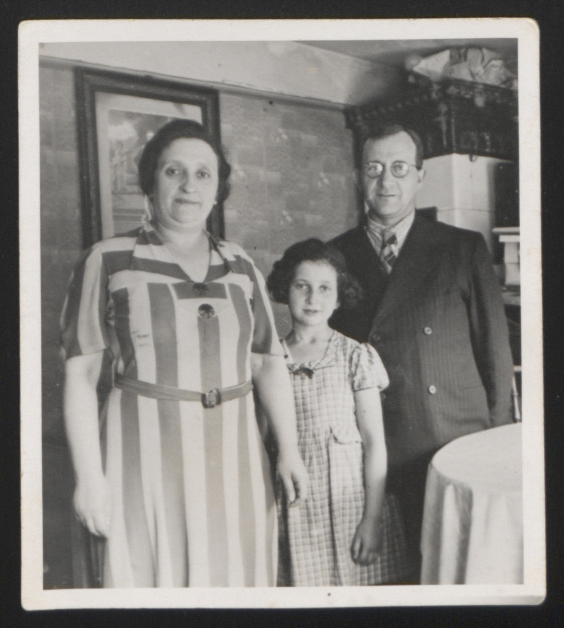 Portrait of the Zuckermann family.  Ruth Zuckermann with parents Perle and Heinz shortly before her father's emigration from Germany to England.