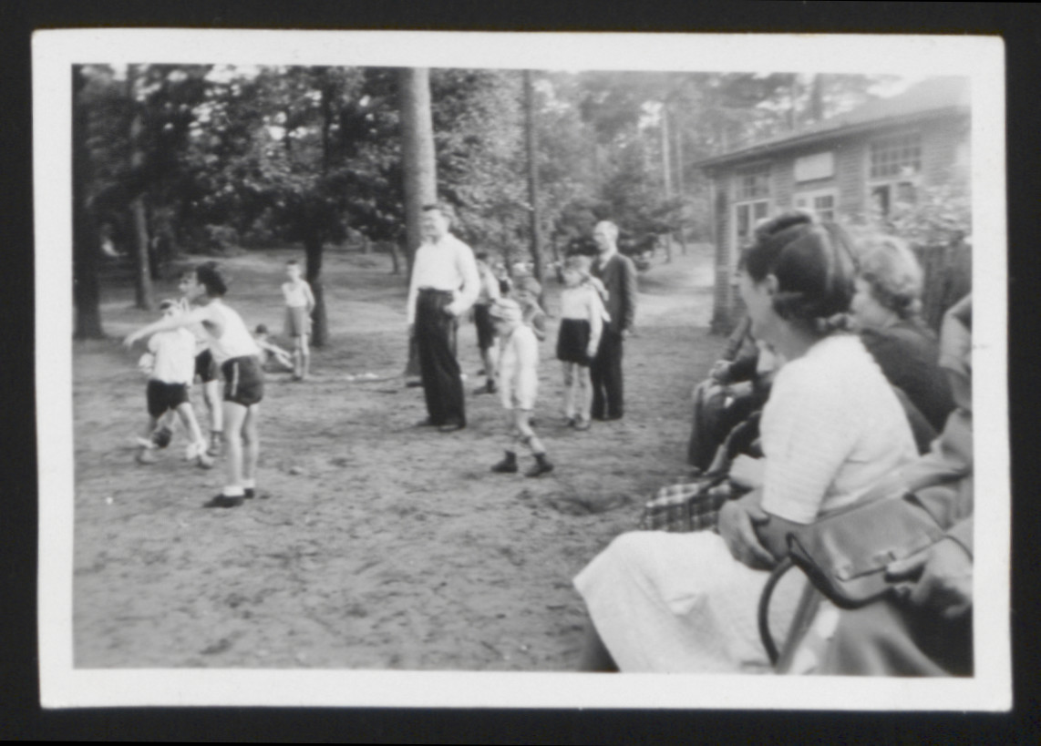 Children from the Jewish orphanage in Hamburg play sports outside.   Among those pictured is the teacher Julius Hamburger (standing center in white).