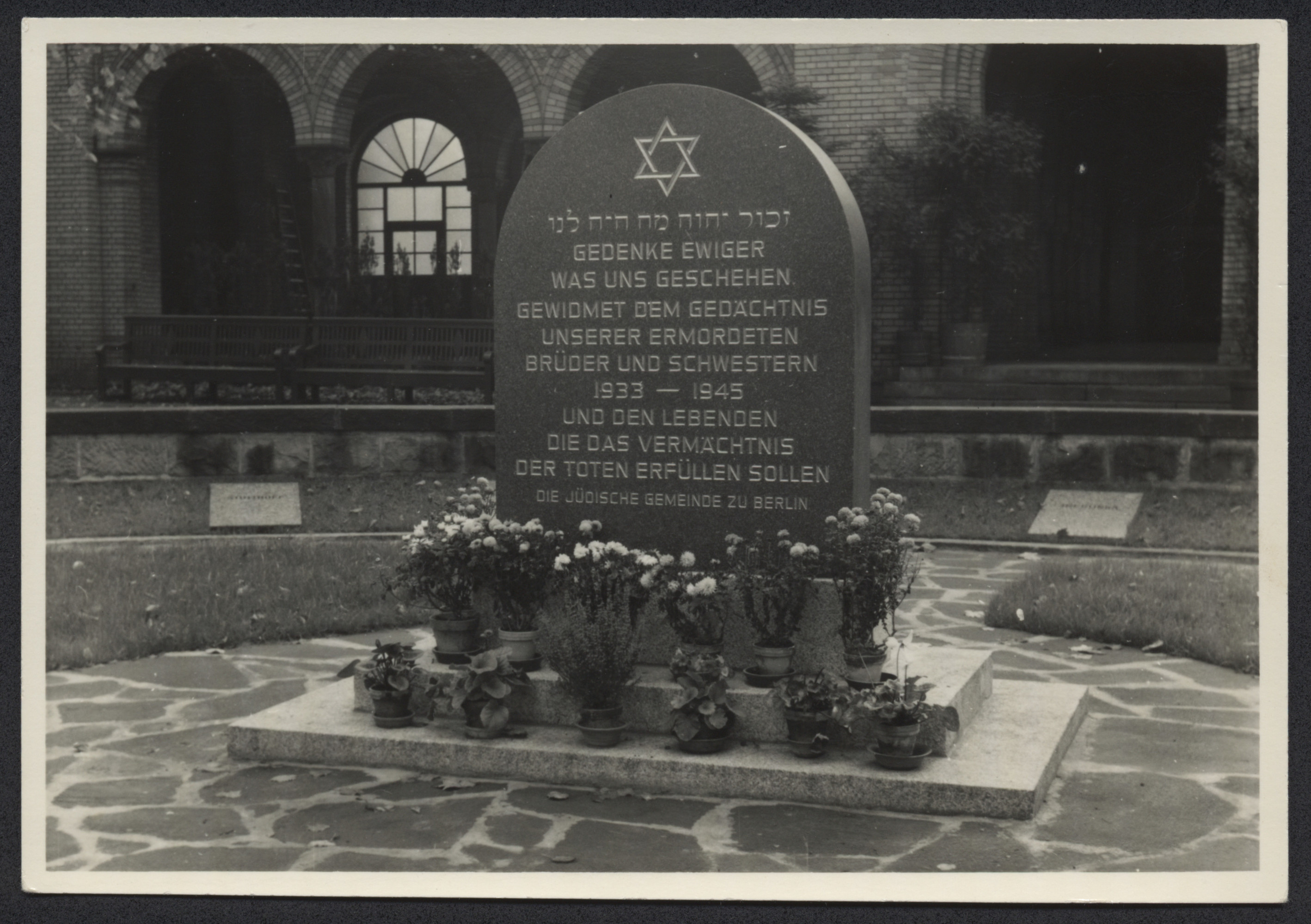 "Memorial  to Holocaust victims in Berlin.  The engraving on the stone reads, ""Gedenke ewiger was uns geschehen gewidmet dem gedachtnis unserer ermordeten brueder und schwestern 1933-1945  und den lebenden die das vermachtnis der toten erfuellen sollen die Juedische gemeinde zu berlin."" [In eternal memory of what happened to us, dedicated to the thought of our murdered brothers and sisters 1933-1945, and to the living fulfilling their legacy.  The Jewish Community of Berlin. ]"