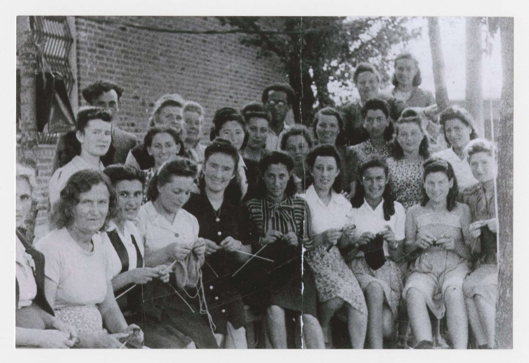 Group portrait of women in the knitting group in Heidenheim.  Among those pictured is Szaindl (Shirley) Goldfarb.