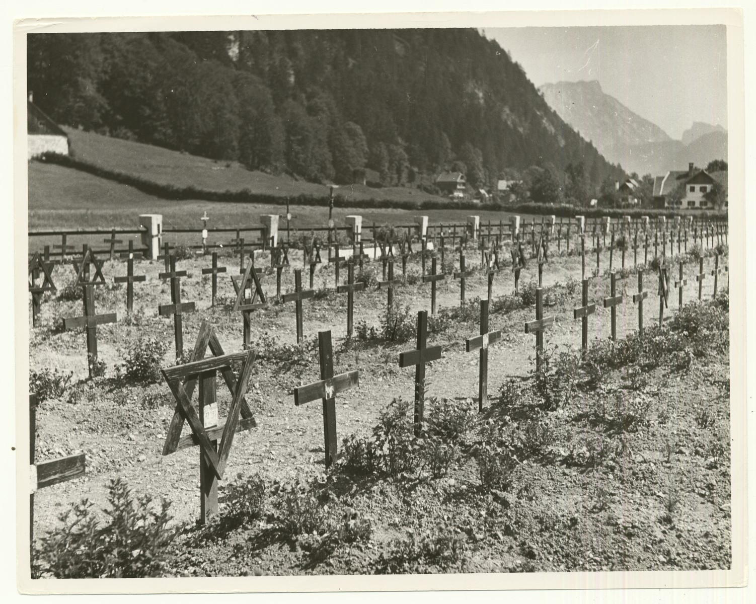 """Cemetery of the former concentration camp near Ebensee, Austria  Ebensee was used as a displaced persons camp after liberation, a cemetery for the victims of the concentration camp was laid out in 1946.  The handwritten caption on the back of the photograph reads: """"Cemetery of a former Concentration Camp near Ebensee, Austria."""""""
