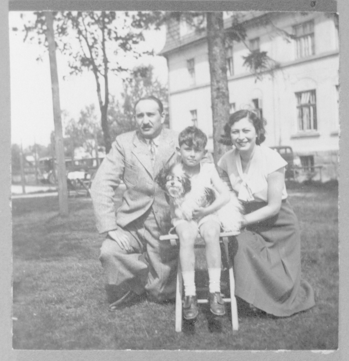 Roman Frister poses with his parents, Franciszka and Wilhelm, on the grounds of the Villa Maria in Szczyrk, Poland.