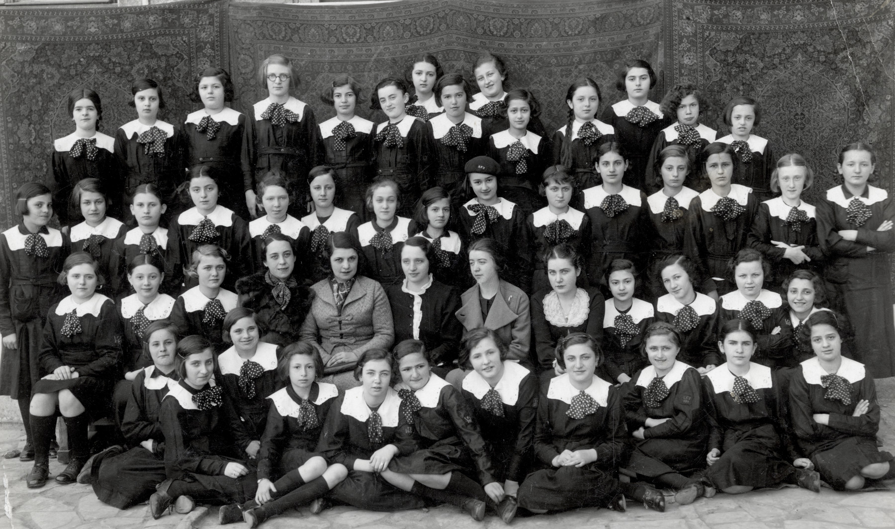 A group photograph of children from the Ultea Domna School, directed by Balan.   The group of children includes Thea Kollenberg (pictured second row from the bottom on the far right).