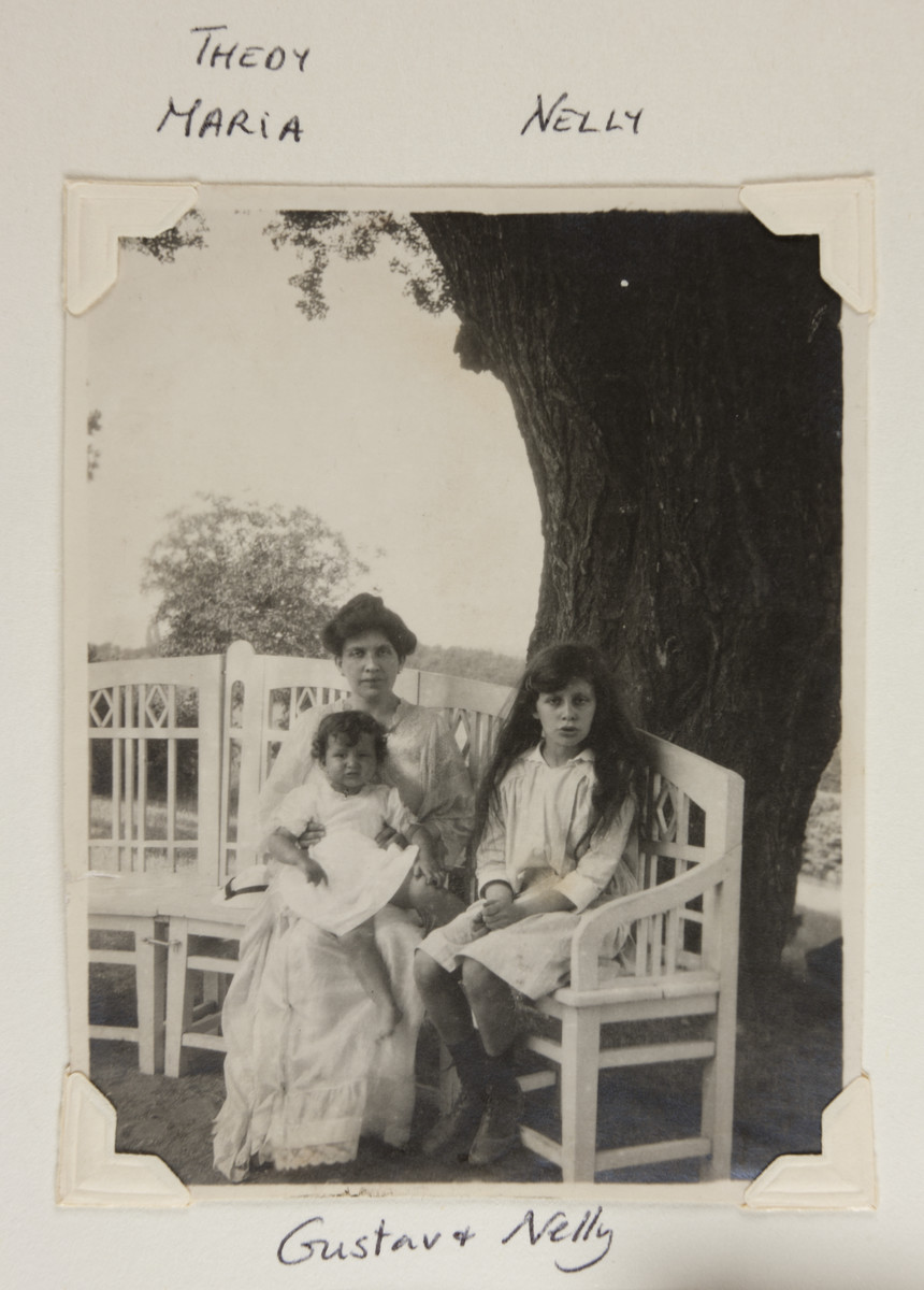 Therese Bloch-Bauer seated on a bench with daughters Maria (left) and Luise.