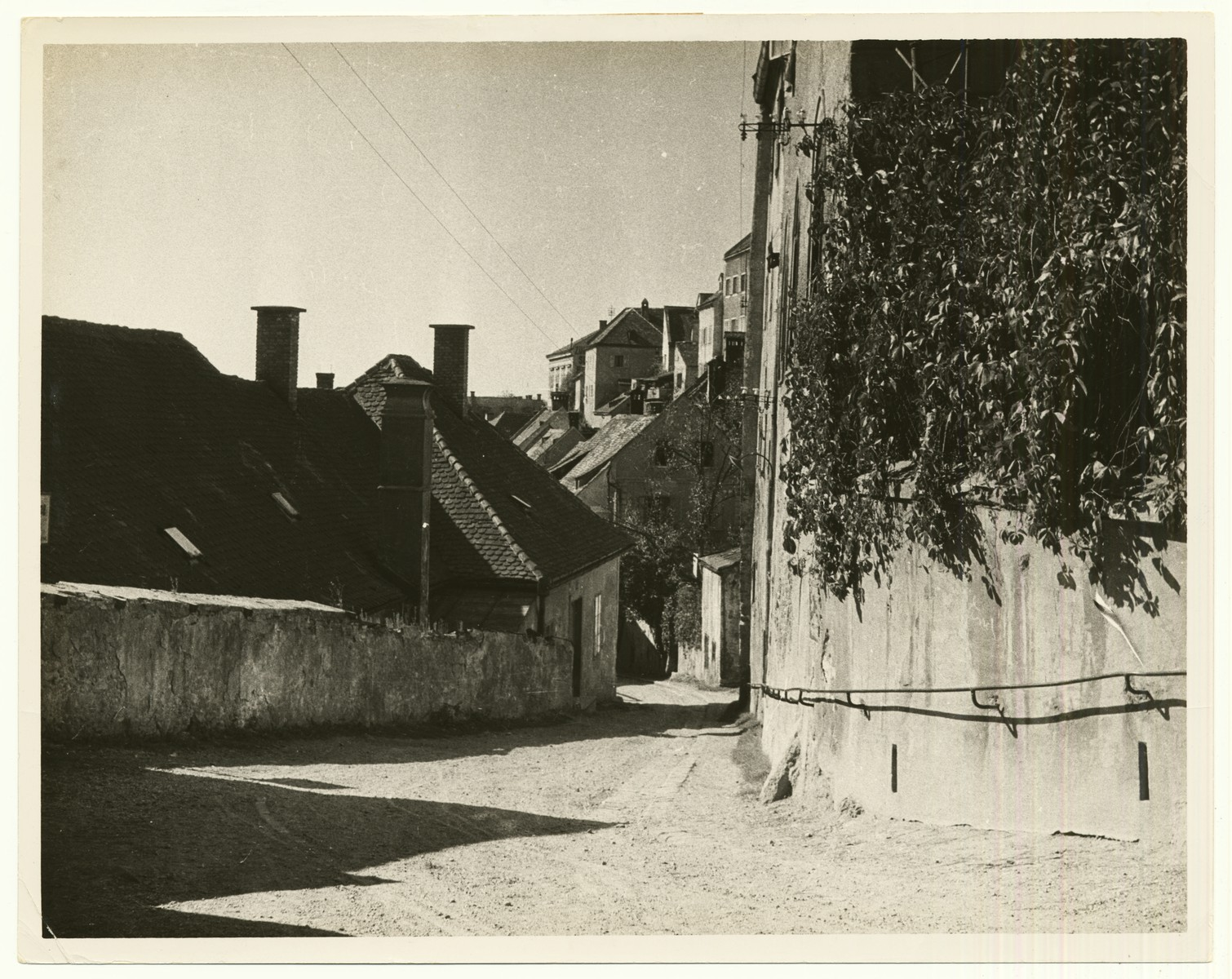 "Street scene in Steyr, Austria.  The handwritten caption on the back of the photograph reads: ""Steyr, Austria."""